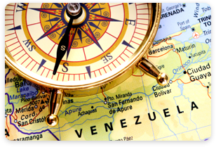 A compass on a map of Venezuela.