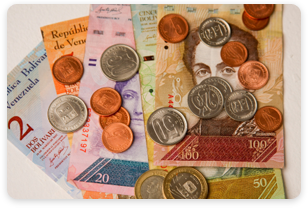 Venezuelan currency coins and bolivar paper money.