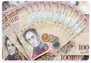 Stack of Venezuelan currency - Bolivar and coins