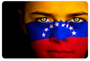 woman's face painted with the Venezuelan flag.