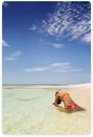 Woman sun bathing on the beach - Los Roques.